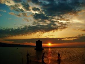 foto di tramonto tramonto Tramonto sulla laguna Orbetello (GR)